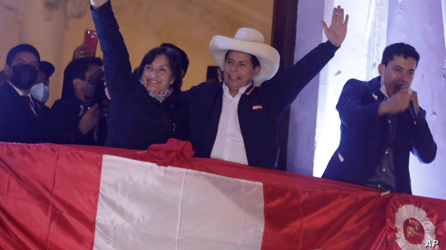 Pedro Castillo, center, celebrates with his running mate Dina Boluarte after being declared president-elect of Peru by election…