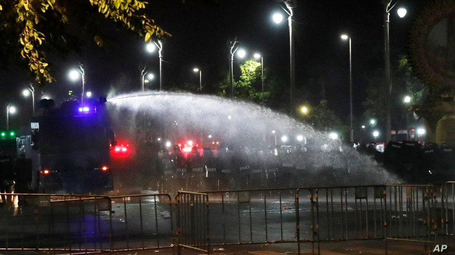Police use water cannons to disperse protesters Saturday, March 20, 2021 in Bangkok, Thailand. Thailand's student-led pro…