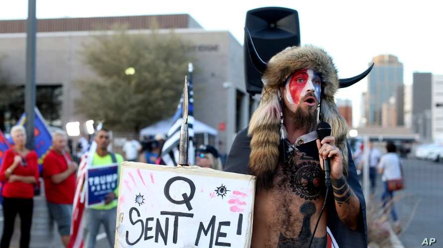 FILE - In this Nov. 5, 2020, file photo, Jacob Anthony Chansley, who also goes by the name Jake Angeli, a Qanon believer speaks…