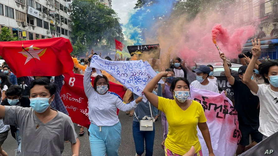 Students protest against the February military takeover by the State Administration Council as they march at Kyauktada township…