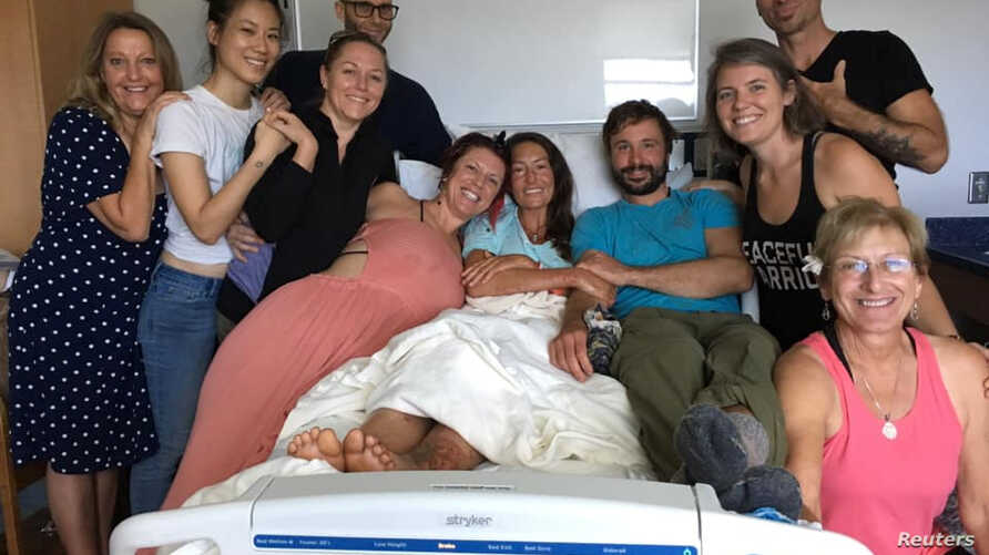 Amanda Eller, a yoga instructor who went missing for 17 days while hiking in Maui's Makawao Forest Reserve, poses for a photo from her hospital bed at Maui Memorial Medical Center in Hawaii.