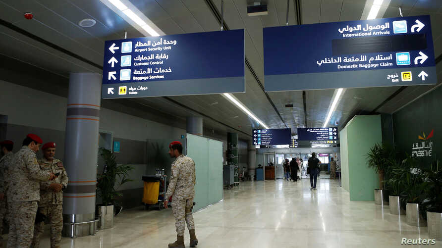 FILE - Saudi security officers are seen at Saudi Arabia's Abha airport after it was attacked by Yemen's Houthi group in Abha, June 13, 2019.