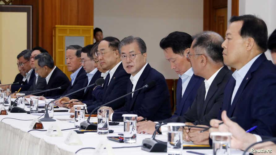 South Korean President Moon Jae-in speaks during a meeting with executives from South Korea's top 30 conglomerates at the Presidential Blue House in Seoul