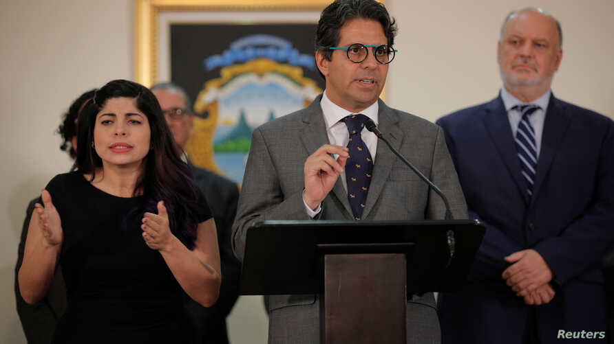 "Costa Rica's Education Minister Edgar Mora speaks to the media after resigning for protests over his ""progressive"" ideas at the presidential house in San Jose, Costa Rica, July 1, 2019."