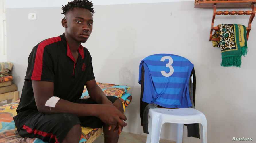 African migrant sits inside a local Red Crescent chapter in Zarzis