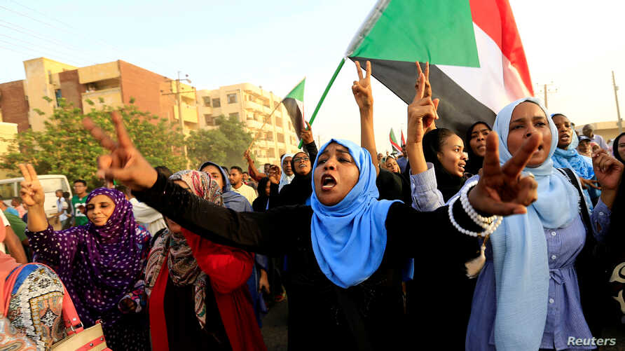 Sudanese protesters march during a demonstration to commemorate 40 days since the sit-in massacre in Khartoum North