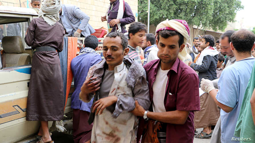 A man injured by an air strike on a market in Yemen's Saada province arrives at a hospital to receive medical attention, July 29, 2019.