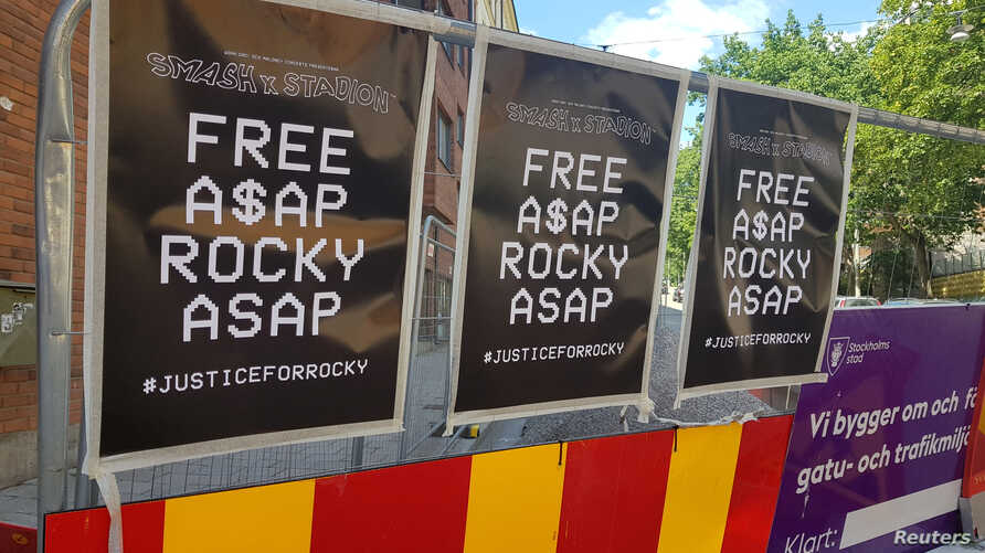 FILE - Posters asking for A$AP Rocky to be freed line the wall across from the jail where the American rapper is being held on charges of assault in Stockholm, Sweden, July 25, 2019.