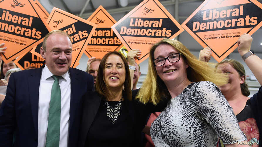 Liberal Democrats candidate Jane Dodds, center, reacts after winning the by-election for the district of Brecon and Radnorshire at the Royal Welsh Showground, near Builth Wells in Wales, Britain Aug. 2, 2019.