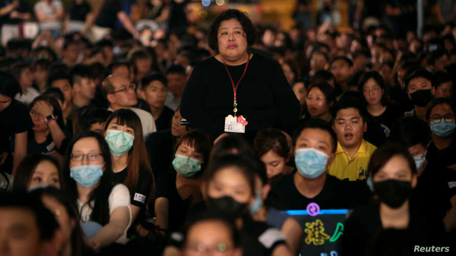 Members of Hong Kong's medical sector attend a rally to support the anti-extradition bill protest in Hong Kong, Aug. 2, 2019.