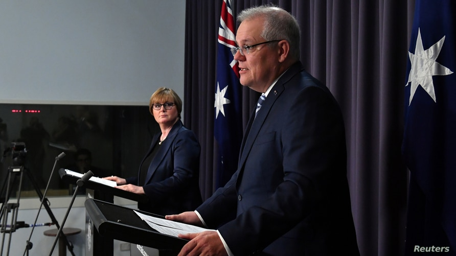 Prime Minister Morrison speaks during a press conference revealing a state-based cyber attack in Canberra