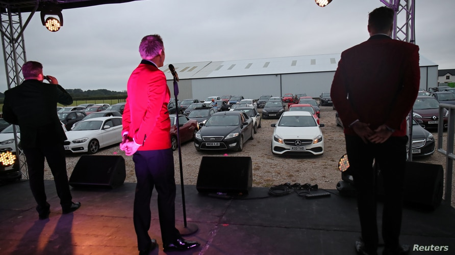 People attend a drive-in concert of the Jersey Boys in Preston