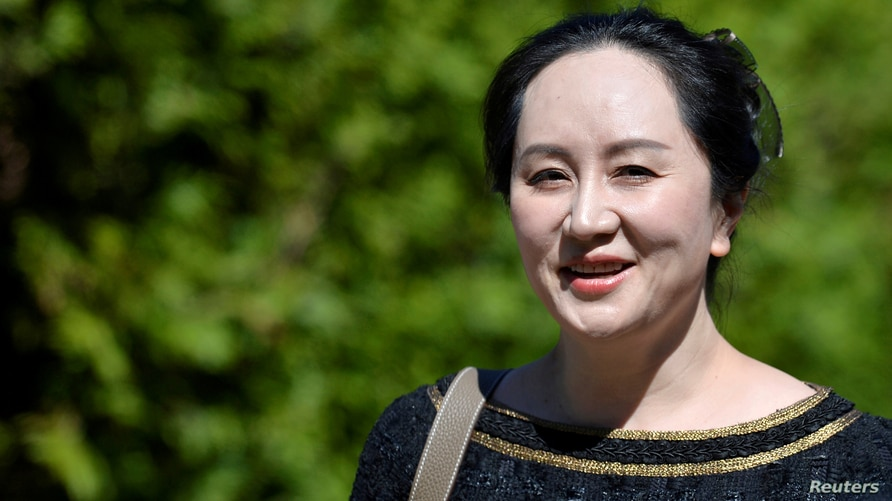 FILE PHOTO: Huawei Technologies Chief Financial Officer Meng Wanzhou leaves her home to attend a court hearing in Vancouver