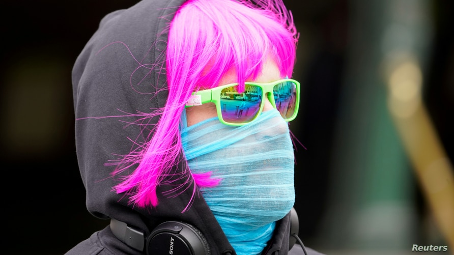 A person wears a scarf as a protective face mask in Melbourne, the first city in Australia to enforce mask-wearing to curb a resurgence of COVID-19