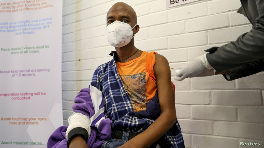 FILE PHOTO: A volunteer receives an injection from a medical worker during the country's first human clinical trial for a potential vaccine against the novel coronavirus, in Soweto