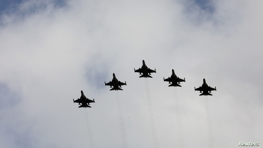IDF aircraft fly in formation during an inauguration ceremony of a maintenance centre for F-16 fighter jets, in Taichung