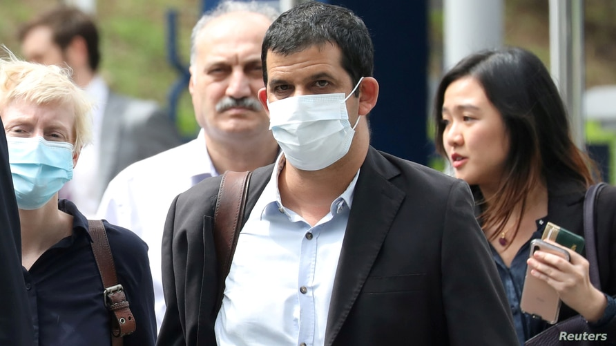 FILE PHOTO: Al Jazeera senior producer Drew Ambrose leaves Bukit Man police headquarters after being questioned by the Malaysian police over a documentary on the country's arrests of undocumented migrants, in Kuala Lumpur