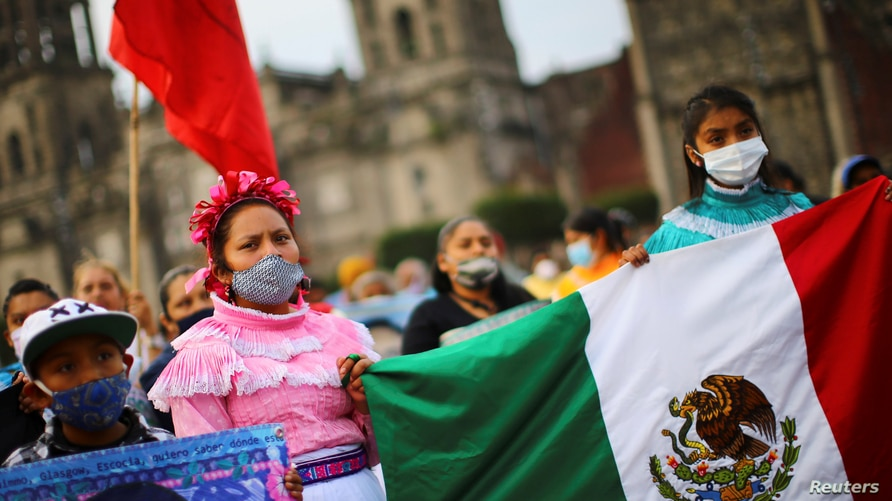 Relatives of the 43 missing students of the Ayotzinapa Teacher Training College march on the 6th anniversary of their disappearance in Mexico City