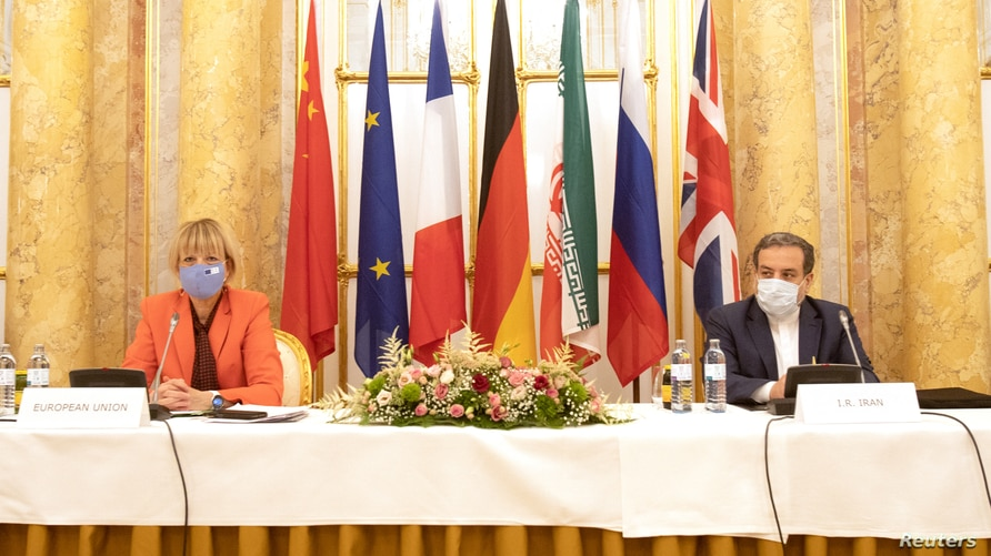 Iran's top nuclear negotiator Araqchi and EEAS Schmid attend a meeting in Vienna