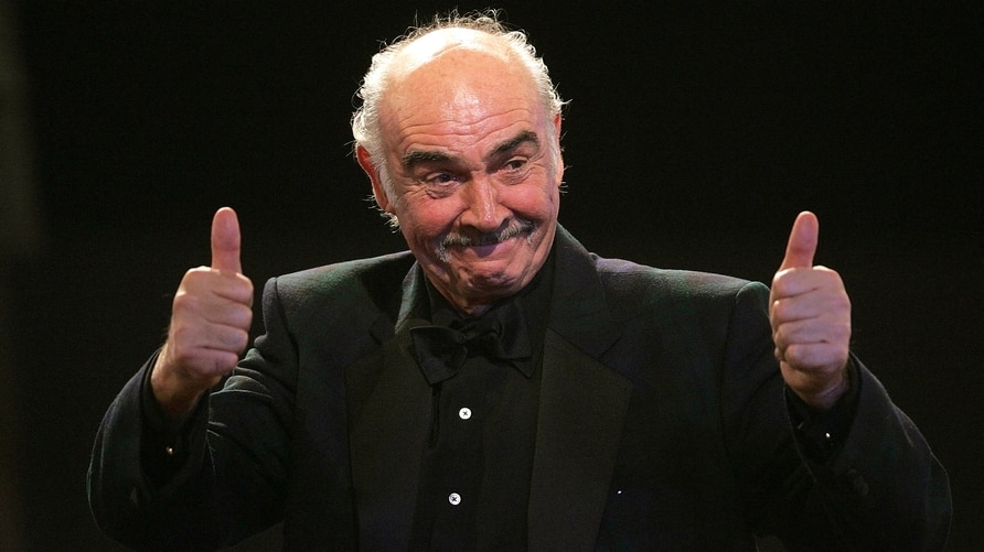 FILE PHOTO: British actor Connery reacts on stage during European film award ceremony in Berlin