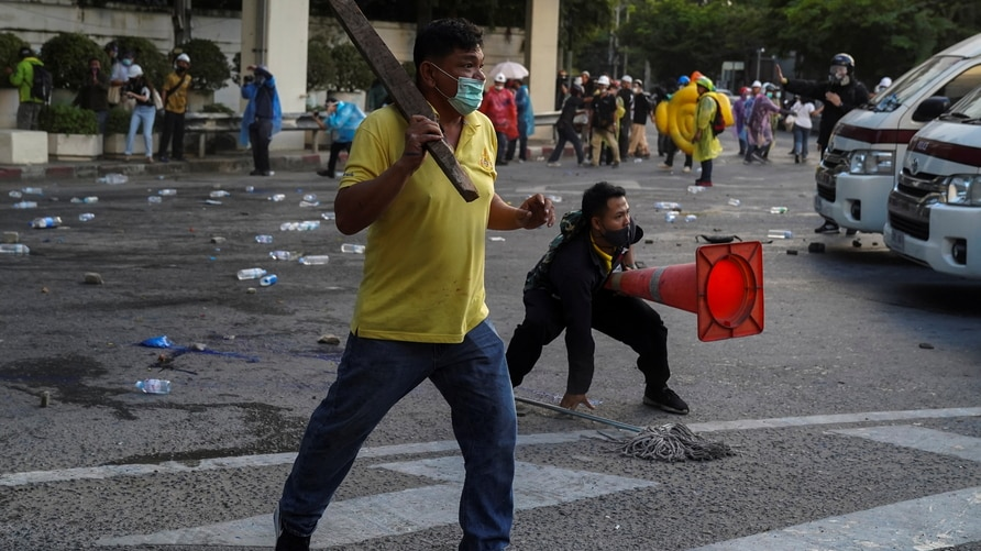 Royalists clash with pro-democracy protesters during an anti-government protest in Bangkok