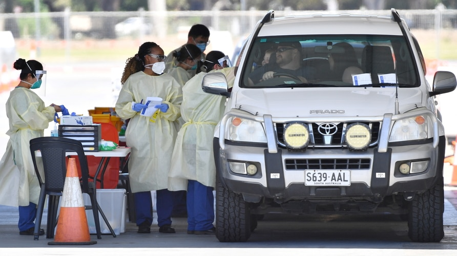 Health workers test the South Australia public at a drive-through COVID-19 testing site in Adelaide