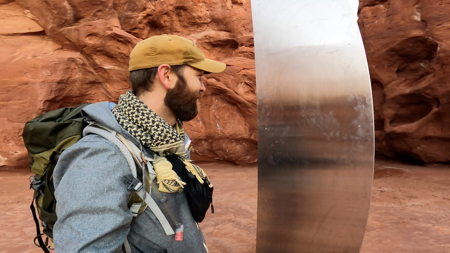 David Surber is seen after discovering the location of a metal monolith in Red Rock Desert, Utah, Nov. 27, 2020.
