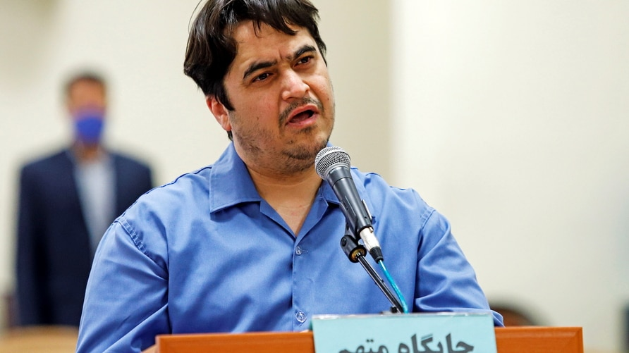 Ruhollah Zam, a dissident journalist who was captured in what Tehran calls an intelligence operation, speaks during his trial in Tehran