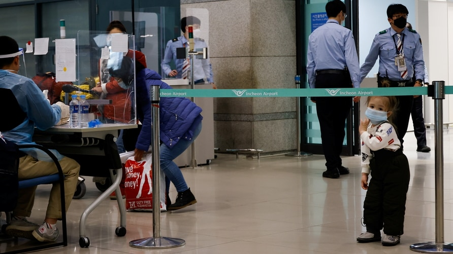 Passengers from overseas arrive at the Incheon International Airport, in Incheon