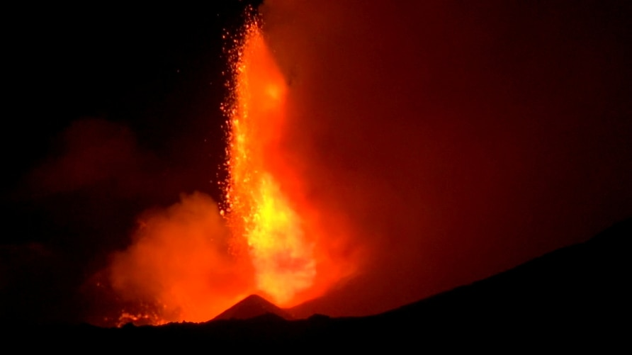 Spectacular eruptions from Mount Etna light up the sky during the night in this still image taken from video filmed in Nicolosi, Catania, Italy, Dec. 14, 2020.