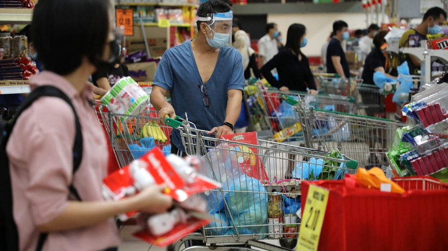 People line up to pay at a supermarket, amid the coronavirus disease (COVID-19) outbreak in Kuala Lumpur