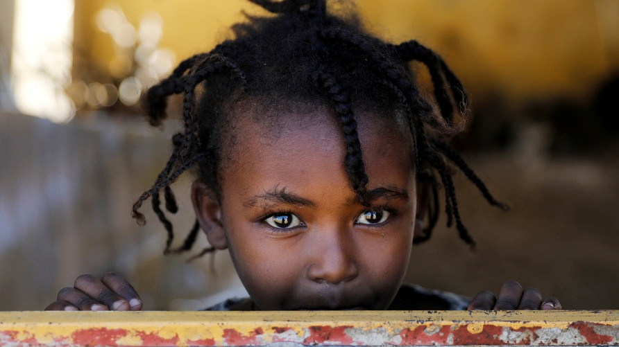 FILE PHOTO: An Ethiopian girl stands at the window of a temporary shelter, at the Village 8 refugees transit camp, which houses Ethiopian refugees fleeing the fighting in the Tigray region, near the Sudan-Ethiopia border