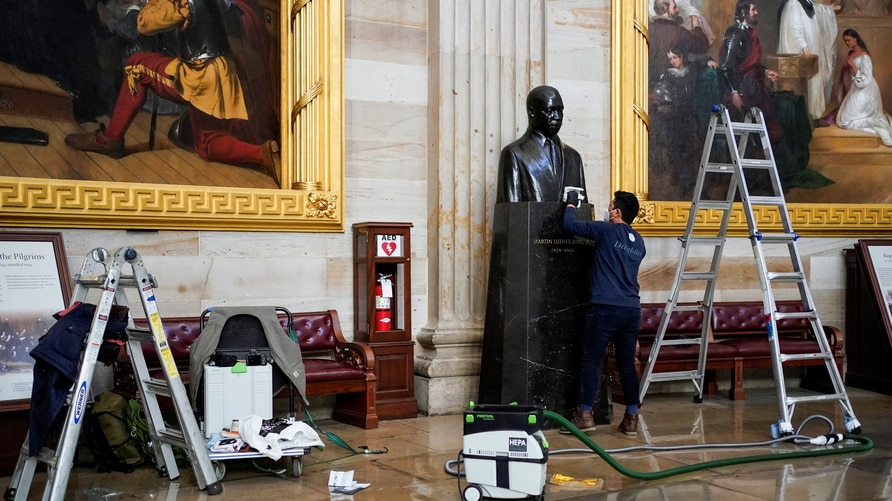 Statues are cleaned in the U.S. Capitol in Washington