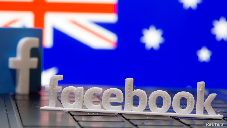 FILE PHOTO: A 3D printed Facebook logo is seen in front of displayed Australia's flag in this illustration photo