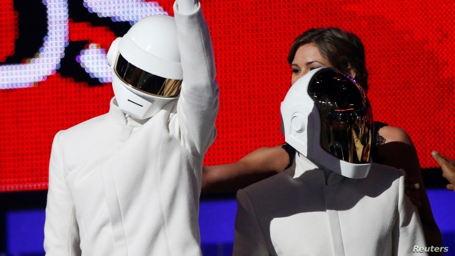 """FILE PHOTO: Daft Punk accepts the award for Record of the year for """"Get Lucky"""" at the 56th annual Grammy Awards in Los Angeles"""