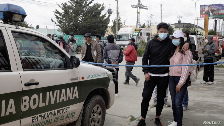 A couple wait for information about the UPEA (El Alto Public University) accident, in El Alto