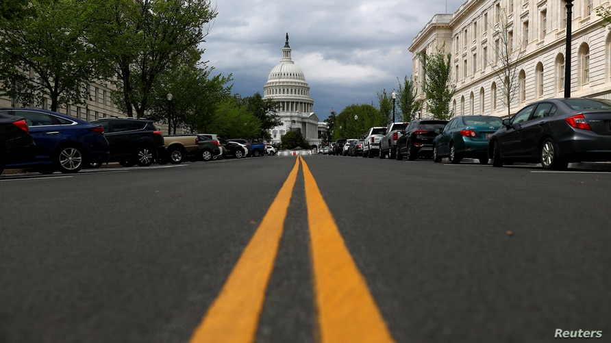 FILE PHOTO: The U.S. Capitol dome is pictured ahead of a vote on the additional funding for the coronavirus stimulus economic relief plan, amid the coronavirus disease (COVID-19) outbreak in Washington