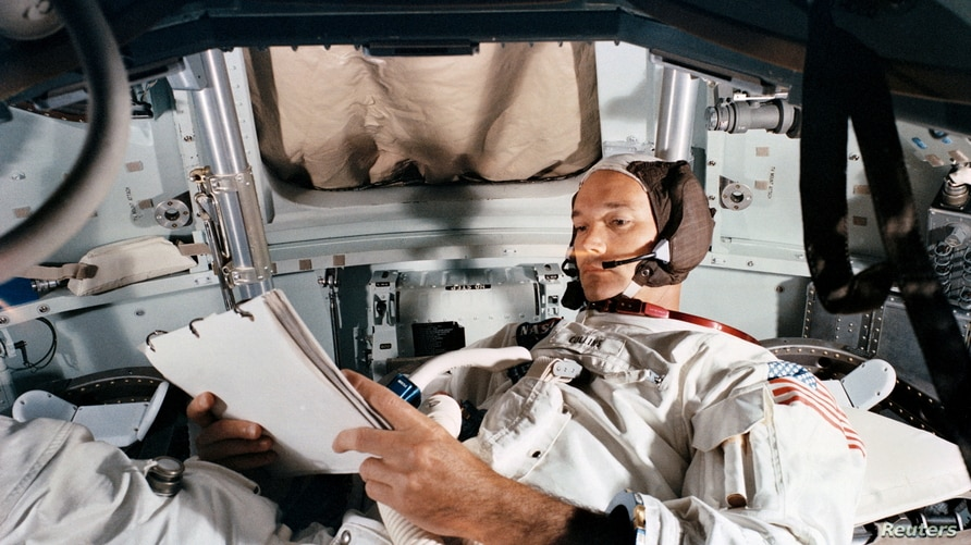 FILE PHOTO: Command Module pilot Michael Collins practices in the CM simulator at Kennedy Space Cente
