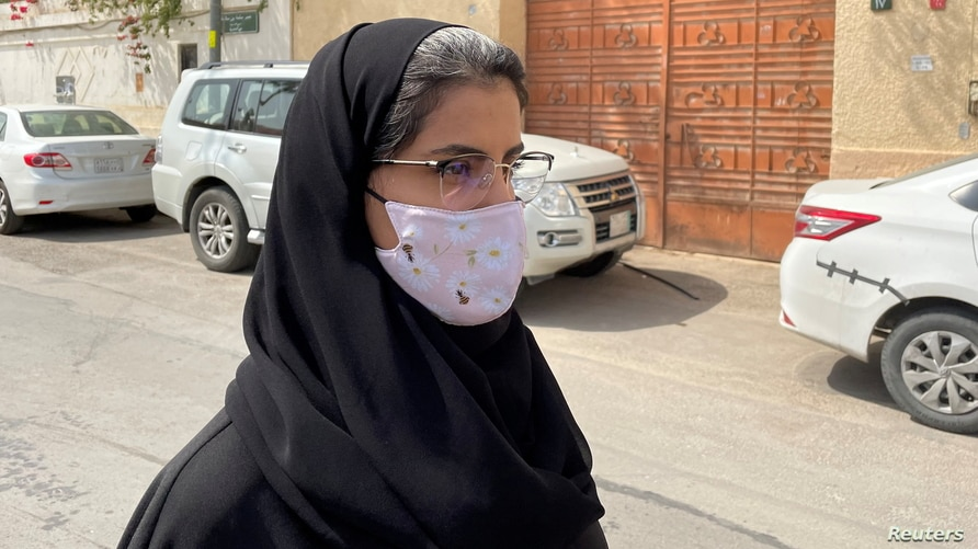 Saudi activist Loujain Al-Hathloul makes her way to appear at a special criminal court for an appeals hearing in Riyadh
