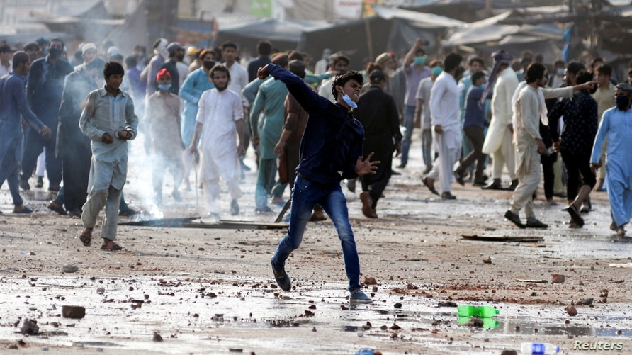 FILE PHOTO: Supporters of the Tehrik-e-Labaik Pakistan (TLP) Islamist political party protest against the arrest of their leader in Lahore