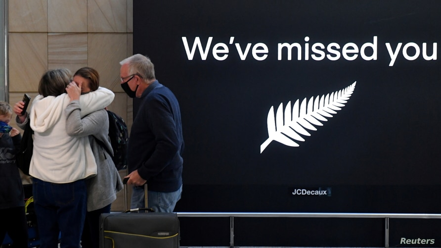 New Zealand travellers are seen as quarantine-free travel between Australia and New Zealand begins, at Sydney International Airport