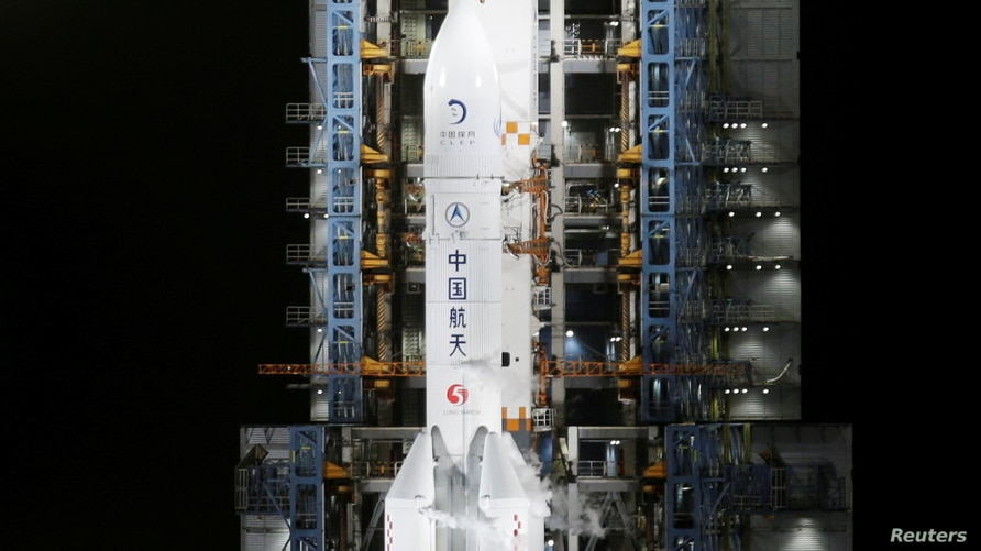 FILE PHOTO: The Long March-5 Y5 rocket, carrying the Chang'e-5 lunar probe, is seen before taking off from Wenchang Space Launch Center, in Wenchang