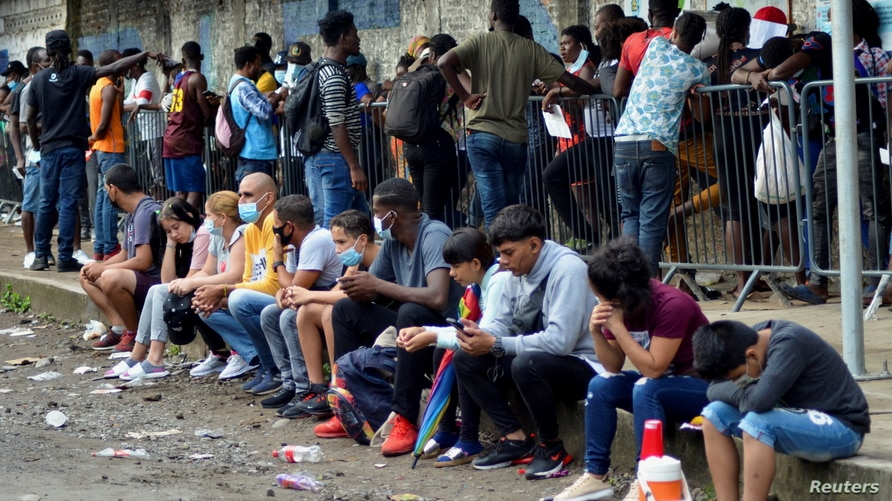 Migrants queue to apply for asylum and refugee status, in Tapachula