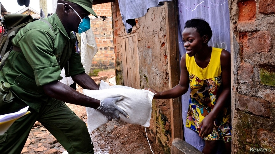 FILE PHOTO: Government distribution exercise to civilians affected by the lockdown, in Kampala