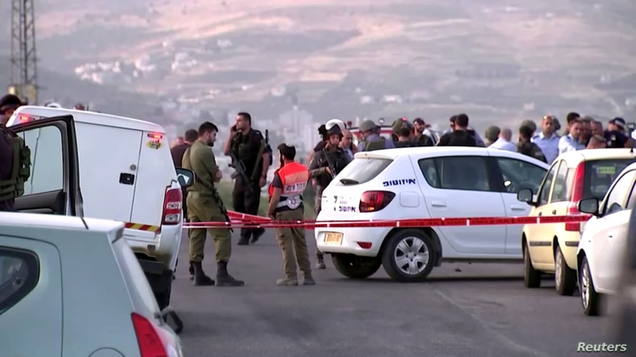 FILE PHOTO: Members of Israeli forces gather at the scene of a shooting incident in the Israeli-occupied West Bank