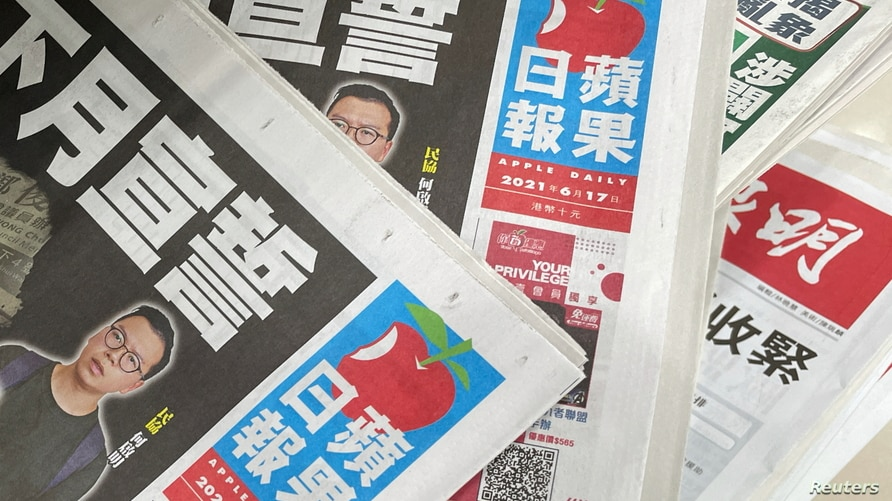 Copies of Next Digital's Apple Daily newspapers are seen at a newsstand in Hong Kong