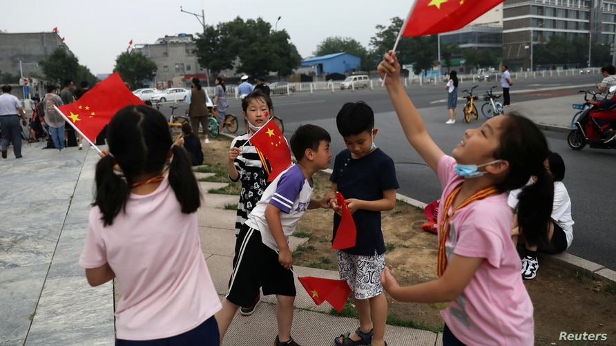 Ahead of a rehearsal for the celebrations to mark the 100th founding anniversary of the Communist Party of China, in Beijing