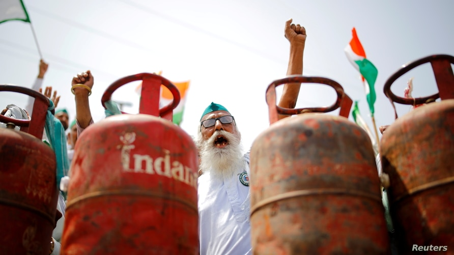 A farmer shouts slogans during a protest against the hike in fuel prices, at the Delhi-Uttar Pradesh border in Ghaziabad