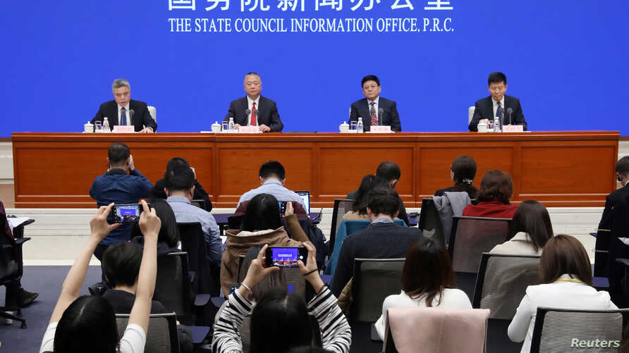 Officials of Ministry of Public Security, National Health Commission and National Medical Products Administration attend a news conference on fentanyl-related substances control, in Beijing, China April, 1, 2019. REUTERS/Stringer ATTENTION EDITORS - THIS IMAGE WAS PROVIDED BY A THIRD PARTY. CHINA OUT.