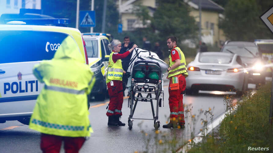 Emergency crews are seen near a stretcher after a shooting in al-Noor Islamic center mosque, near Oslo, Norway, Aug. 10, 2019.